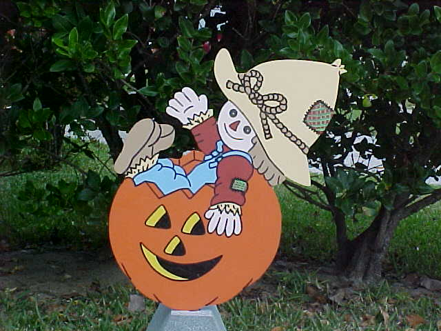 Scarecrow in Jack-O-Lantern Lawn Sign
